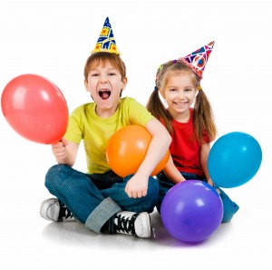Kids in birthday caps
